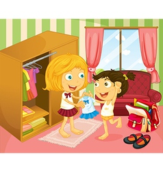 A girl helping her sister with her uniform vector image vector image