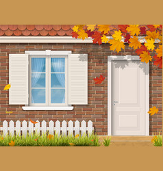 Brick house facade in autumn season vector