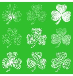 set of scribbled hand drawn clovers vector image