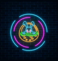 Glowing neon sign of easter bunny in basket in vector