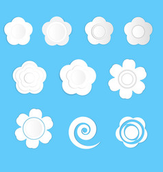 white paper flowers on a blue background vector image