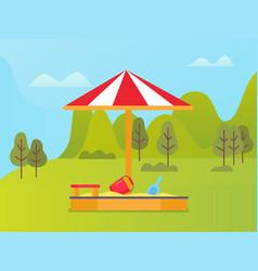 bucket and shovel in sandbox green nature vector image