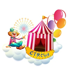 A clown beside a circus tent with balloons vector image vector image