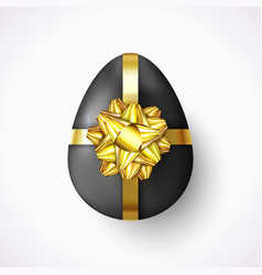 realistic easter egg with gold ribbon and gift bow vector image