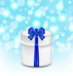 Gift box with blue bow on glowing background vector image