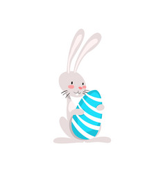 cute white easter bunny holding egg funny rabbit vector image