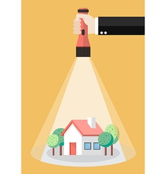 Hand holding flashlight glow to the house property vector image