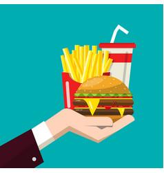 fast food in human hand flat design of hamburger vector image
