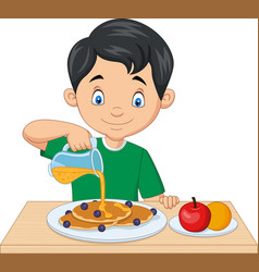 little boy flowing maple syrup on pancakes vector image