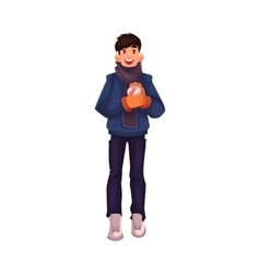 Handsome young man making a snowball vector