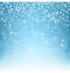 Flying snowflakes on blue background vector