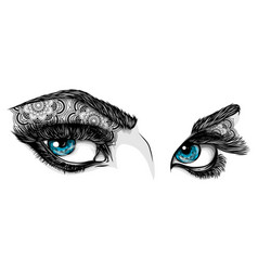 blue eyes of a woman with ornaments vector image