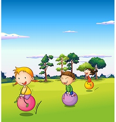 Three kids playing with the bouncing balls vector image