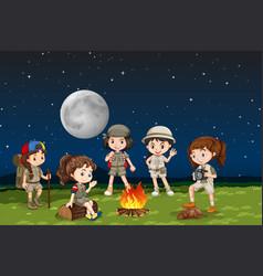 Children around a camp fire vector