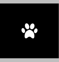 white animal paw print icon isolated on black vector image