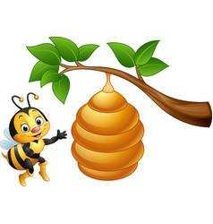 cartoon bee and a beehive vector image