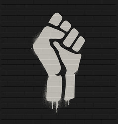 fist raised in protest on a brick wall vector image