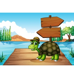 A turtle near the wooden arrowboard vector image