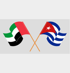 Crossed and waving flags cuba and united vector