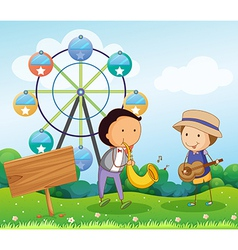 Two boys playing with musical instruments near the vector image vector image