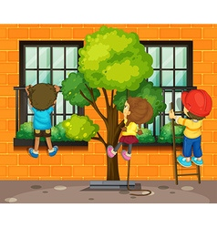 Three children climbing up the window vector