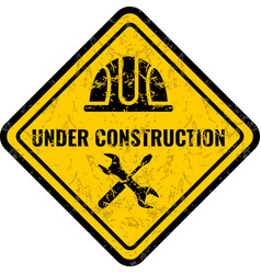 Grunge scratched under construction warning road vector