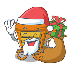 Santa with gift wooden trolley mascot cartoon vector
