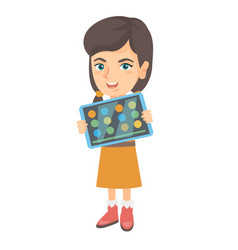 caucasian girl playing game on a tablet computer vector image