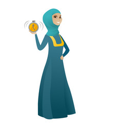 Muslim business woman holding alarm clock vector