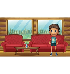 A boy standing inside the house vector