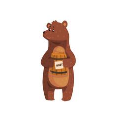 cartoon bear standing with little wooden honey vector image vector image