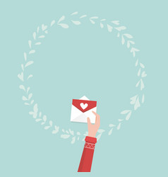 hand holding love letter for valentines day vector image