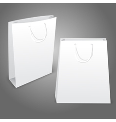 Two realistic white blank paper bags Isolated on vector image