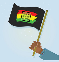hand holding waving black history month flag with vector image