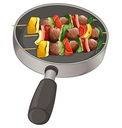 A pan with foods on stick vector image vector image