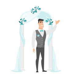 happy groom standing under the wedding arch vector image