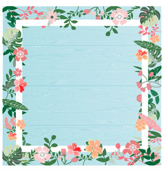 tropical flower and leave on blue wooden surface vector image