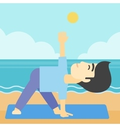 Man practicing yoga triangle pose on the beach vector image