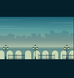 Silhouette of bridge with town scenery at night vector