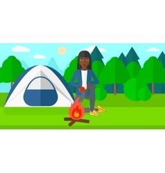 Woman kindling fire vector image