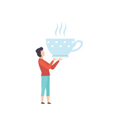 Young man standing with a giant cup of tea vector