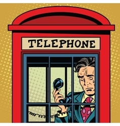 Retro man crying in a phone booth vector