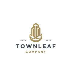 elegant real estate building with leaf logo vector image