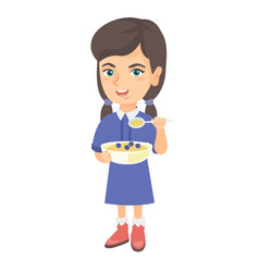 Happy girl holding a spoon and bowl of porridge vector
