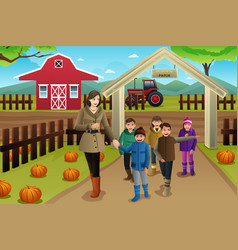 Teacher with students on a pumpkin patch trip vector
