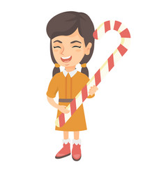 caucasian little girl holding christmas candy cane vector image