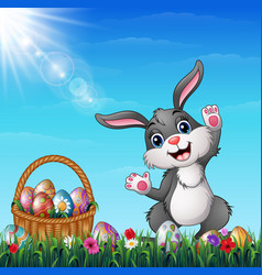 Easter bunny with easter basket full of decorated vector