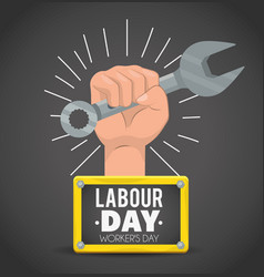 Hand with wrench and emblem to labour day vector