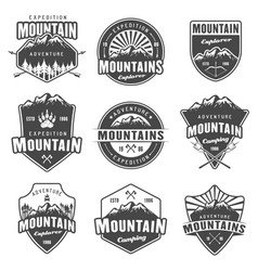 mountain travel set of black retro emblems vector image