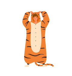 Funny young man wearing tiger kigurumi for pagama vector